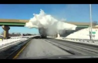 Snow Explodes As Truck Passes Under Bridge (Amazing Footage)