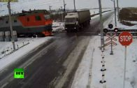 Two trains destroy a trapped truck on the tracks