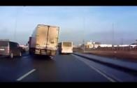 Truck avoids crash on slippery road in daredevil tactic